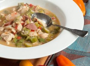 chicken seafood gumbo in white bowl; recipe from northwest kidney centers