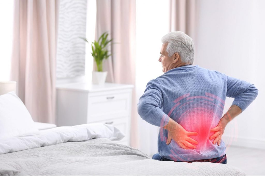 An elderly man experiencing Pain Associated with Kidney Disease