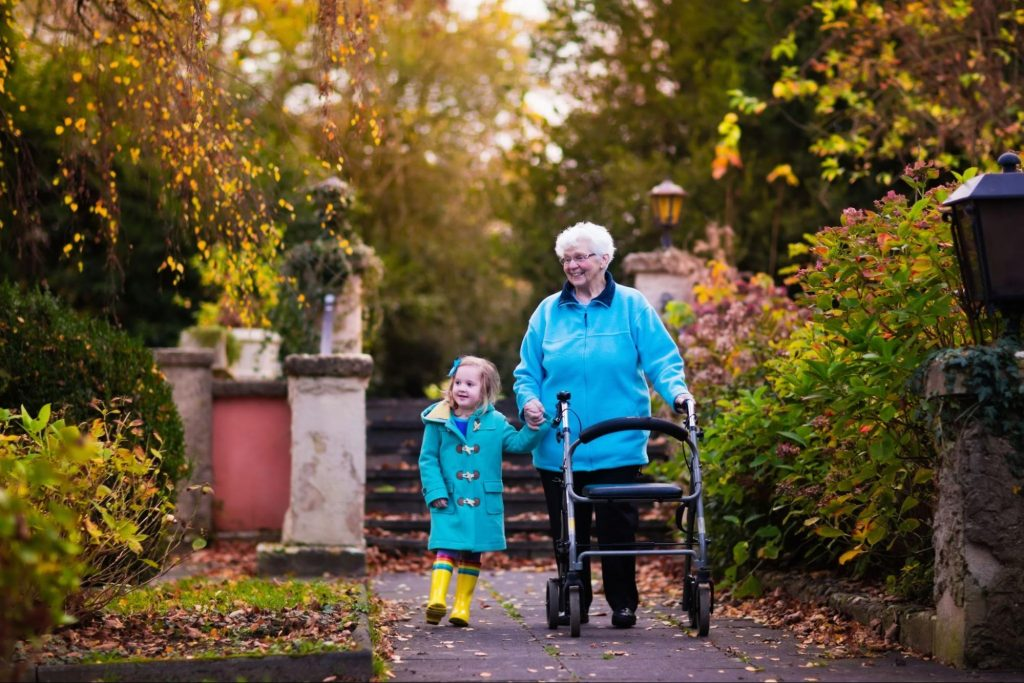 a grandmother living with CKD and her grandchild walking in the autumn